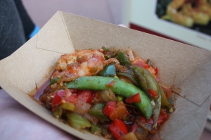 Grilled sweet and spicy bush berry shrimp with pineapple, peppers, onions, and snap peas from Australia.